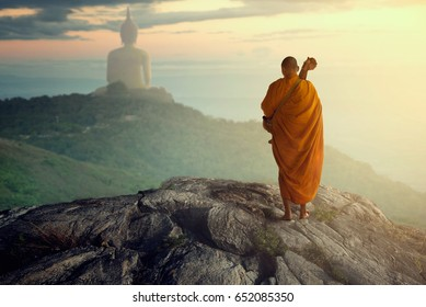 Monk faith religion, Monk buddhist walking to big Buddha on mountain Thailand in Asia