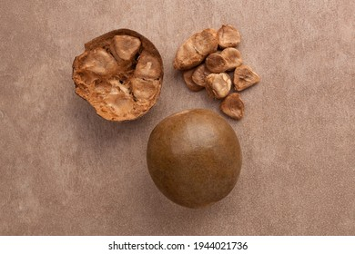 Monk fruit, siraitia grosvenorii, Luo han guo. Whole and cross section top view.