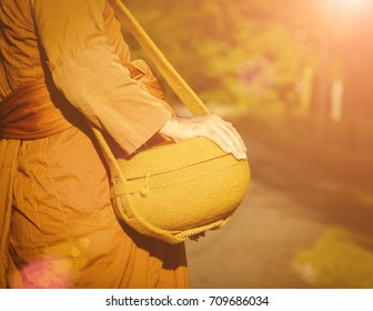 A monk goes for alms in morning.