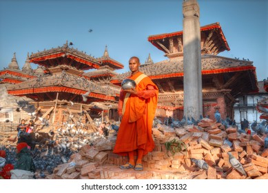 MONK TO KATMANDU, NEPAL, TURKEY - FEBRUARY 14, 2017: A monk stands on the ruins of a temple in Kathmandu.