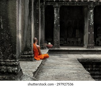 A monk meditates at the Angkor Wat temple in Siem Reap Cambodia.