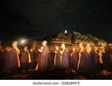 the monk performed Pradaksina ritual by walking around Borobudur Temple. These monks will carry the lotus and sing the Buddhang Saranang Gaccami song. vesak day, indonesia, 2015