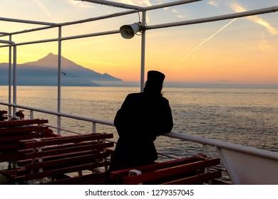 monk pilgrim on the way to holy mountain athos