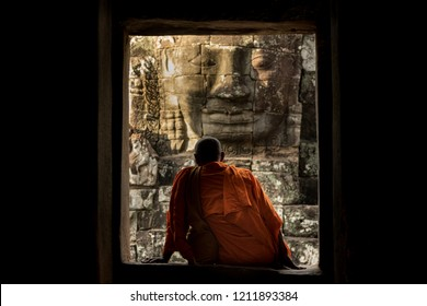 Monk seated down at Bayon temple