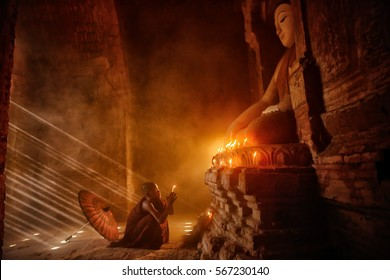 Monk with sun light from outside to inside, Bagan Myanmar