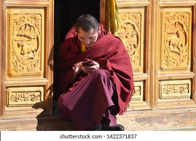 A monk using smartphone, 8 March, 2018, Yunnan, China