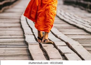 Monk Walk on the Wood Bridge