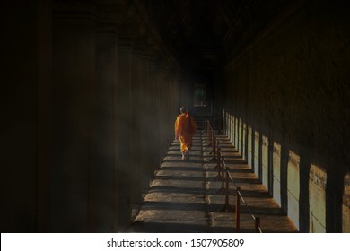 Monk walking at Angkor Wat in Cambodia,it is the largest religious monument in the world and a World heritage listed complex. Siem Reap, Cambodia, Monk walking back and forth