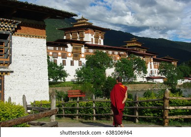 Monk walking into Punakha Dzong