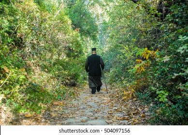 Monk walking and praying, Mount Athos