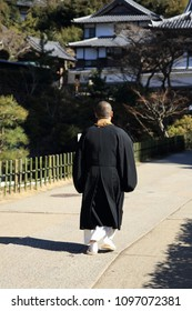 A monk walking in the precincts of the temple