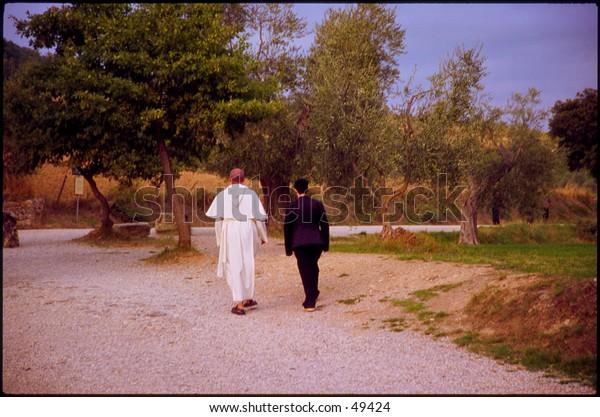 Monk in white, woman in black