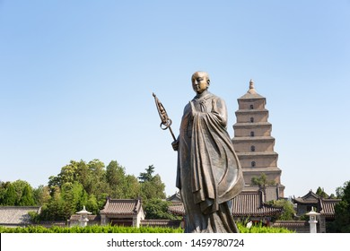 monk xuanzang statue with giant wild goose pagoda in xian,China