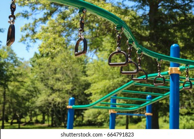monkey bars and rings at the jungle gym playground.  Overhead equipment on commercial school playground design. Recess, back to school, playground, risky playground equipment, older kids, active kid