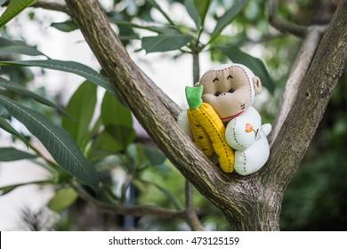 monkey doll on the tree - Shutterstock ID 473125159