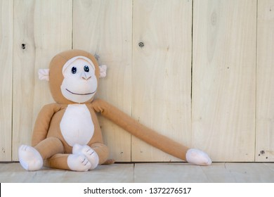 Monkey Doll on the wooden floor.