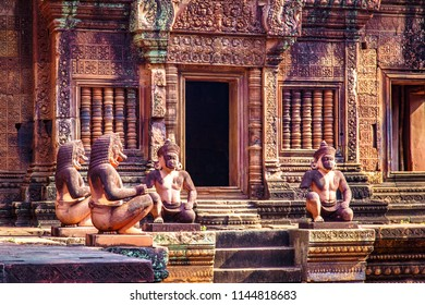 Monkey God guardian statues kneel in front of the entrance, Banteay Srei temple, Siem Reap, Cambodia