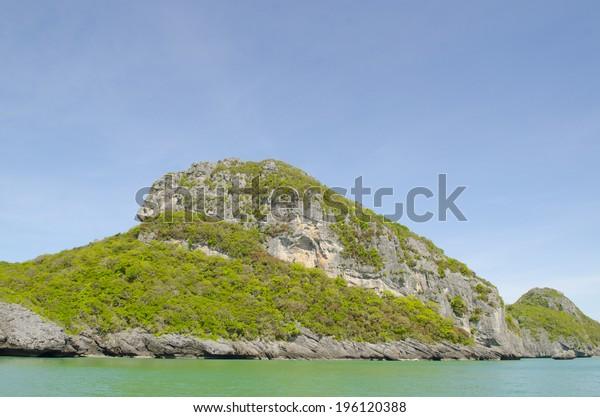 Monkey island against blue sky. Angthong National Marine Park. Gulf of Thailand, Ko Samui, Kingdom of Thailand