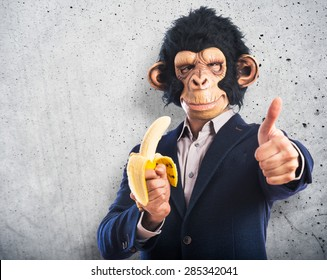Monkey man eating a banana over textured background