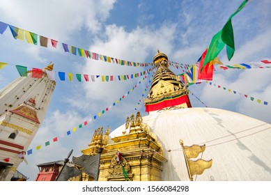 Monkey temple or Swayambhunath stupa with Buddha eyes symbol and prayer flag, an ancient religious architecture atop a hill in the Kathmandu Valley, buddhist monastery in Kathmandu, Nepal
