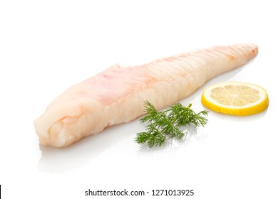 Monkfish filet raw with dill and lemon white isolated