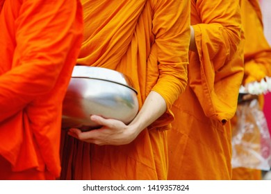 monk's alms-bowl, give food offerings to a Buddhist monk