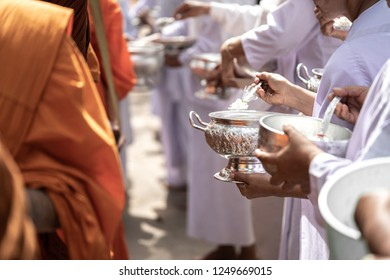 The monks of the Buddhist Sangha(give alms to a Buddhist monk), which came out of the Buddhist offerings in the morning. In order to demonstrate faith faithfully perform the duties recently.