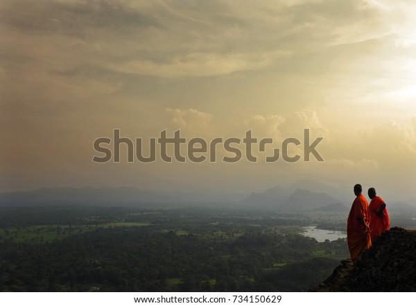 Monks in the evening light in Sigiriya, Sri Lanka