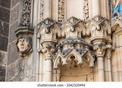 Monk's face on a facade of  basilica. Architectural decor details of Basilica of St. Peter and St. Paul, Vysehrad fortress, Prague, Czech republic.
