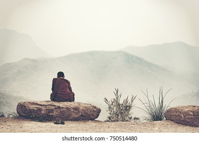 The monks are meditating on the mountain.