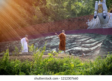 The monks and novices are cleaning the temple yard.