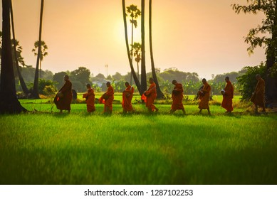 Monks, novices walk in alms and the sun is rising in the morning, in Ayutthaya 30/7/2018