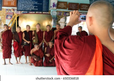 Monks pose for a souvenir photo at Manuha Stupa in Bagan, Burma (Myanmar) on Tuesday 2 January 2012