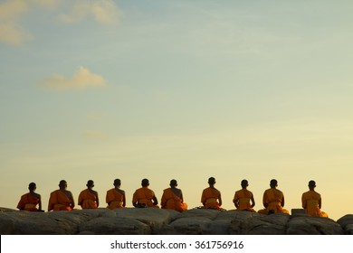 monks sit meditation on the rock