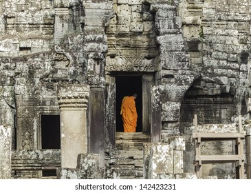 Monks walk through passageways at Angkor wat, Cambodia