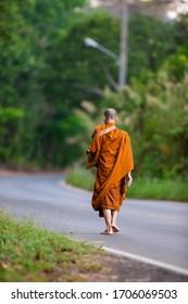 Monks walking alms round Thailand