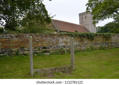 MONKTON, KENT/UK-JUNE 10 2018: Ancient village stocks outside the church of St Mary Magdalene in Monkton, a church was on this site before the Domesday survey in 1086, the church dates from circa 1190