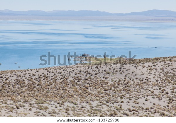 Mono Lake is a large, shallow saline lake in Mono County, California, The lack of an outlet causes high levels of salts to accumulate in the lake.
