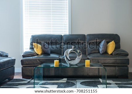 monochromatic color scheme living room with greys yellow candles and yellow accent pillows & Monochromatic Color Scheme Living Room Greys Stock Photo (Edit Now ...