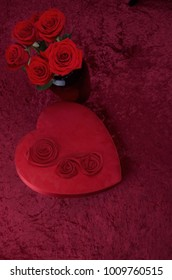 Monochromatic Red Vertical Background With Heart Shaped Box and Bouquet Of Roses On Red For Valentines Or Wedding