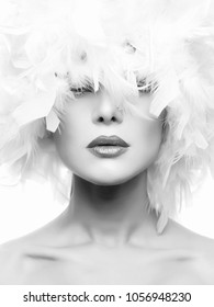 Monochrome Beauty Portrait of Beautiful Girl in white feathers Hat. young Woman Face, closeup