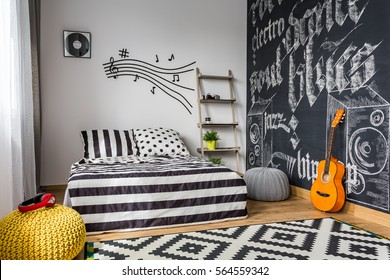 Monochrome bedroom interior for young guitar musician