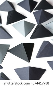 Monochrome black and gray tetrahedrons background. Great for using in web.