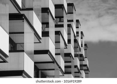 monochrome building facade with glazed balcons