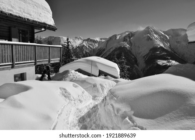 Monochrome of Chalet with a view under deep snow with blue skies in a ski resort