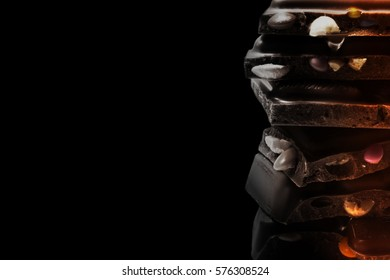 The monochrome  chocolate tower of various parts isolated on black background.