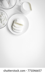 monochrome concept with dairy products on white table top view m