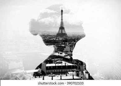 Monochrome double exposure portrait of attractive girl with Paris