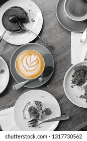 Monochrome food on a wooden table with coffee latte in color