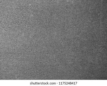 monochrome gray grainy gritty textured metal background